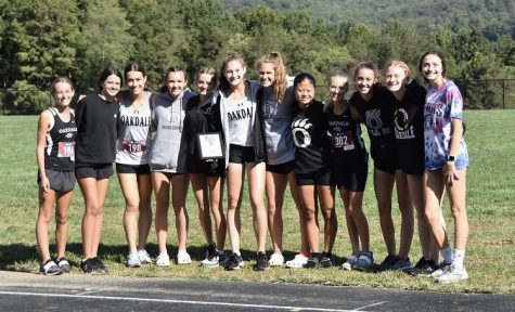 The girls cross country team poses after winning the Cougar Challenge at Catoctin High School.  From left to right: Lynn Everly, Sydney Frownfelter, Zhana Ivanova, Madison Chorney, Caylin Walker, Sarah Anderson, Sydney Querry, Shantou Meyers, Bailey Roman, Kayla Brightman, Abby Stum, and Kylie McGlinchey
