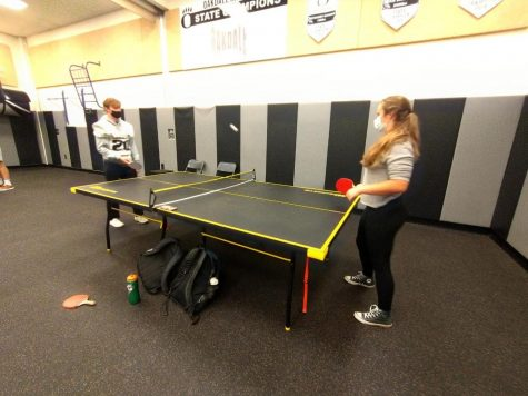 Two Oakdale High students go face-to-face in a ping pong match during the SET ping pong club meeting.