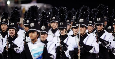 Pictured above is drum major Amelia Rampersad leading the Bear Band onto the field for a performance.